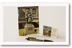 state school postcard, pen, and magnet